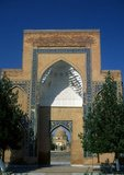 The Gūr-e Amīr or Guri Amir (Persian: گورِ امیر) is the mausoleum of the Asian conqueror Tamerlane (also known as Timur) in Samarkand, Uzbekistan. It occupies an important place in the history of Persian Architecture as the precursor and model for later great Mughal architecture tombs, including Humayun's Tomb in Delhi and the Taj Mahal in Agra, built by Timur's descendants, the ruling Mughal dynasty of North India. It has been heavily restored.<br/><br/>  Gur-e Amir is Persian for 'Tomb of the King'. This architectural complex with its azure dome contains the tombs of Tamerlane, his sons Shah Rukh and Miran Shah and grandsons Ulugh Beg and Muhammad Sultan. Also honoured with a place in the tomb is Timur's teacher Sayyid Baraka.